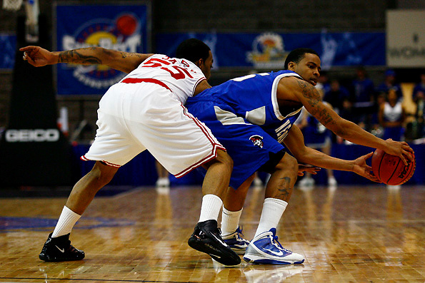 Senior guard Anthony Sally goes for a steal from New Orleans guard Devin McDonald in Western's first game of the Sun Belt Conference Tournament in Hot Springs, Ark., Saturday, March 6. Western defeated New Orleans 83-58. TANNER CURTIS/HERALD