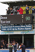 Neal Ardley questions the 4th Official about stoppage time during the Sky Bet League 2 match between AFC Wimbledon and Exeter City at the Cherry Red Records Stadium, Kingston, England on 29 August 2015. Photo by Stuart Butcher.