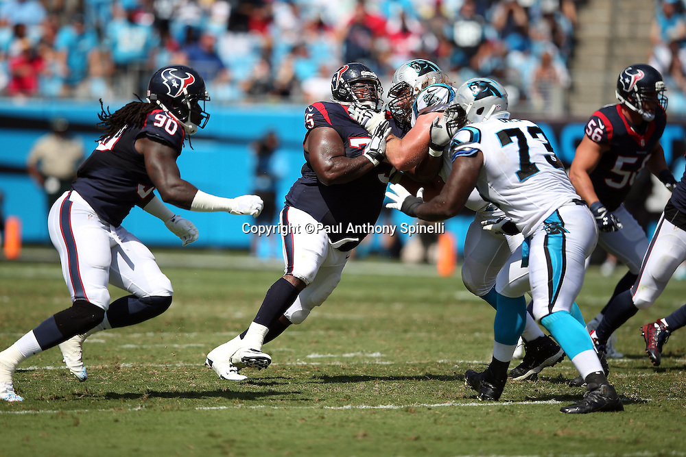 Houston Texans nose tackle Vince Wilfork (75) works his way through a block as Houston Texans outside linebacker Jadeveon Clowney (90) rushes behind him rushes during the 2015 NFL week 2 regular season football game against the Carolina Panthers on Sunday, Sept. 20, 2015 in Charlotte, N.C. The Panthers won the game 24-17. (©Paul Anthony Spinelli)