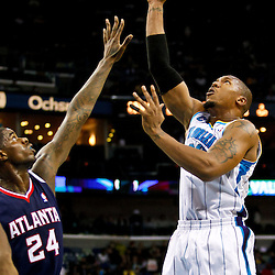 December 26, 2010; New Orleans, LA, USA; New Orleans Hornets power forward David West (30) shoots over Atlanta Hawks small forward Marvin Williams (24) during the second quarter at the New Orleans Arena.  Mandatory Credit: Derick E. Hingle