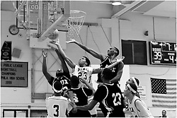 PIAA District 12 Semifinals, South Philadelphia High School, Philadelphia, PA - February 21, 2013; MLK's William Leak is surrounded by opposing players fighting for a rebound. the long rebound rally of multiple attempts fails after all.