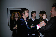 Tom Meighan from Kaspian and Noel Gallagher, Exhibition of photographs by NME photographer Lawrence Watson. Studio 2. Redchurch St. London. 26 April 2007.  -DO NOT ARCHIVE-© Copyright Photograph by Dafydd Jones. 248 Clapham Rd. London SW9 0PZ. Tel 0207 820 0771. www.dafjones.com.