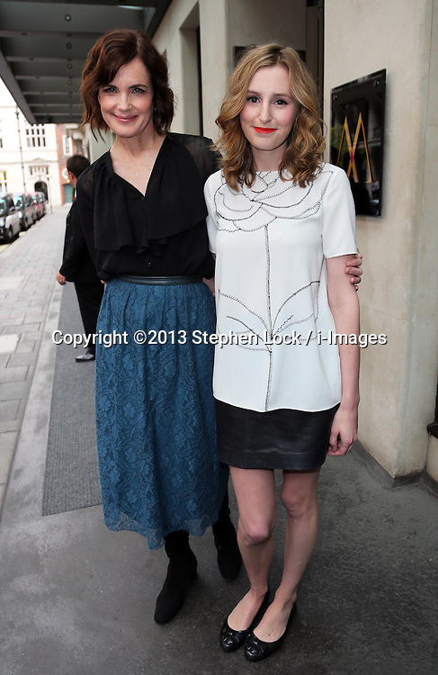 Elizabeth McGovern and Laura Carmichael at the launch of the new series of Downton Abbey, in London, Tuesday, 13th August 2013. Picture by Stephen Lock / i-Images