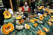 A market vendor selling wedges of pumpkin squash on the streets of Istanbul haggles good naturedly with customers. (Supporting image from the project Hungry Planet: What the World Eats.) Small markets are still the lifeblood of communities in the developing world.
