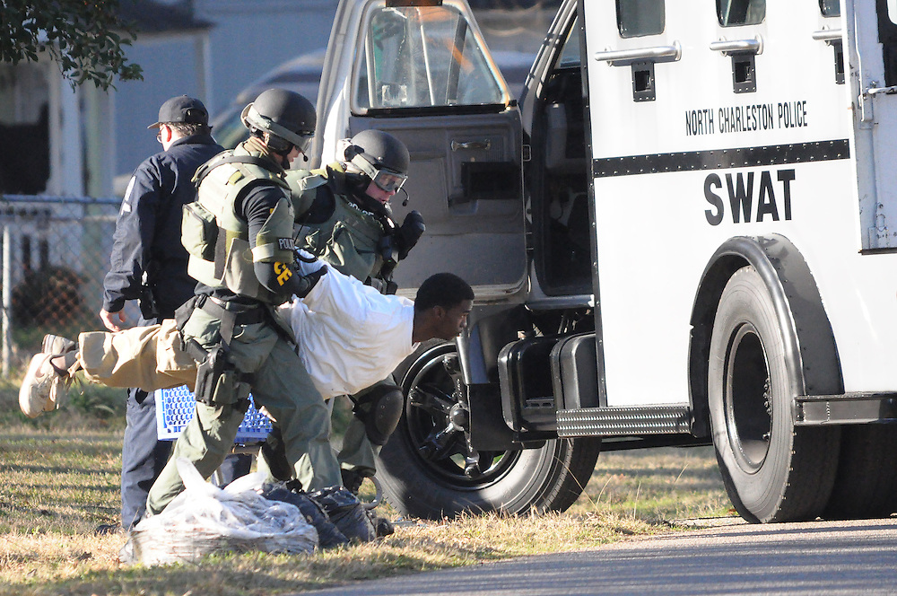 METRO -- ANDREW KNAPP/STAFF -- Jan. 30, 2012 -- SWAT team members from the North Charleston Police Department remove Quantez Jamal Jackson, 21, from a Louise Drive home where the police say the kidnapping suspect had refused to come out early Monday morning.