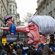 Put It To The People march for a Peoples Vote on 23rd March 2019 in London, United Kingdom. With less than one week until the UK is supposed to be leaving the European Union, the final result still hangs in the balance. An estimated one million protesters gathered to make political leaders take notice and to give the British public a vote on the final Brexit deal. A giant puppet of Teresa May outside Downing Street No 10.