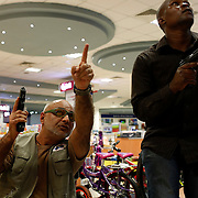 Armed security officers search the premises of a supermarket during the West Gate mall attack in Nairobi, Kenya.