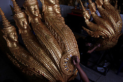September 4, 2017 - Bangkok, Thailand - BThai official artists work on a deity sculpture which will adorn  details the Garuda and banister Naga around about The cremation of Thailand's late monarch Bhumibol Adulyadej at Thonburi Art School in Bangkok, Thailand, 04 September 2017 The cremation of Thailand's late monarch Bhumibol Adulyadej will take place on October 26, the junta announced on April 25, just over a year since his death plunged the kingdom into deep mourning, (Credit Image: © Vichan Poti/Pacific Press via ZUMA Wire)
