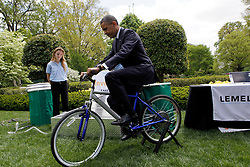 President Barack Obama  tries the bicycle-powered emergency water-sanitation station, created by high schoolers Payton Karr and Kiona Elliot from Oakland Park, Florida in the East Garden of the White House, during the  White House Science Fair. The White House Science Fair celebrates the student winners of a broad range of science, technology, engineering and math (STEM) competitions from across the country. The first White House Science Fair was held in late 2010 in Washington, DC, USA, on April 22, 2013. Photo by Aude Guerrucci/Pool/ABACAPRESS.COM  | 361863_004 Washington Etats-Unis United States
