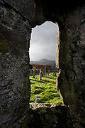 Looking through a window of ther old chapel in Pennygowan Cemetery (Caol Fhaoileann), Salen Isle of Mull, Scotland. This ruined chapel, which served the N portion of the parish of Torosay, is probably of early 13th century date. No medieval references to it have been identified, and its dedication is unknown. The records of the Synod of Argyll in the middle of the 17th century show some uncertainty as to the status of the charge; it is referred to both as a 'Chappell' and as a 'paroach'. The building may already have been derelict at this period, although the earliest evidence of its condition dates from 1787 when it was shown as 'an old kirk' on a map of Torosay parish. Salen (Scottish Gaelic: An t-Sàilean) is a settlement on the Isle of Mull, Scotland. It is on the east coast of the island, on the Sound of Mull, approximately halfway between Craignure and Tobermory. The full name of the settlement is 'Sàilean Dubh Chaluim Chille' (the black little bay of St Columba)...http://www.undiscoveredscotland.co.uk/mull/pennygown/index.html