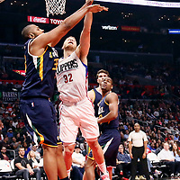 25 March 2016: LA Clippers forward Blake Griffin (32) is blocked by Utah Jazz center Boris Diaw (33) during the Los Angeles Clippers 108-95 victory over the Utah Jazz, at the Staples Center, Los Angeles, California, USA.