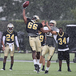 August 9, 2011; Metairie, LA, USA; New Orleans Saints linebacker Dwight Roberson (66) deflects a pass away from tight end Michael Higgins (81) in a rain storm during training camp practice at the New Orleans Saints practice facility. Mandatory Credit: Derick E. Hingle