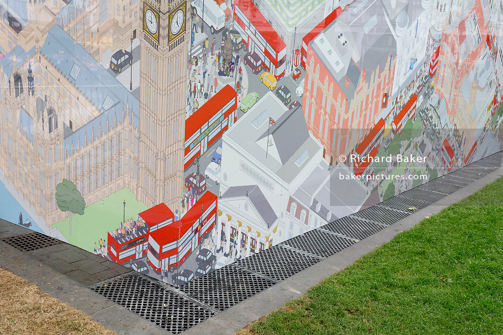 A landscape of grass, drainage and and the corner of a distorted map of London's Westminster and West End district at the rear of a theatre booking kiosk in Leicester Square, on 5th June 2019, in London, England.