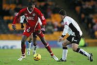 Photo: Paul Thomas.<br /> Port Vale v Bristol City. Coca Cola League 1. 17/12/2005.<br /> <br /> Bristol's Bas Savage tries to go around Steve Rowland.