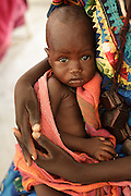Achta Hussain (doesn't know her age), holds her son Hassan Hussain, 5 mo., who is recovering from malnutrition at a UNICEF-sponsored therapeutic feeding center at the Mongo hospital in the town of Mongo, Guera province, Chad on Tuesday October 16, 2012.