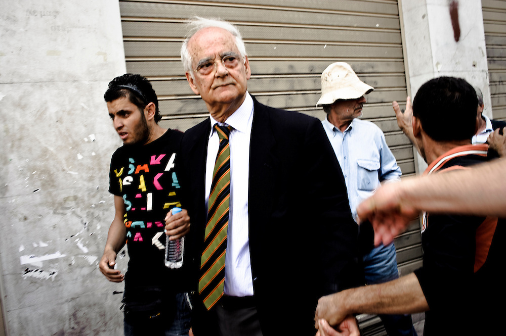 May 1st 2010, May Day demonstrations in Athens, Greece. Former House Speaker Apostolos Kaklamanis was verbally attacked by a group of protesters while walking in central Athens.