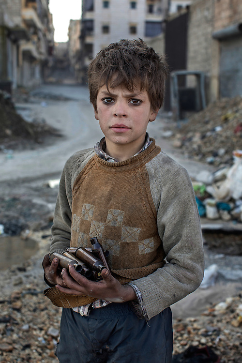 Aleppo, Syria<br /> <br /> Nine year old Alladin collects used ammunition near the frontline in Aleppo to sell as metal.