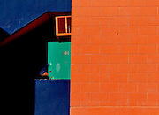 An apartment tenant enters a building painted in the school colors near the University of Florida.