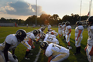 11 SEPT. 2009 -- ST. LOUIS -- Offensive and defensive lineman from Oakville High School run through drills before before the start of the game between the Tigers and Lindbergh High School Friday, Sept. 11, 2009. Photo © copyright 2009 by Sid Hastings.