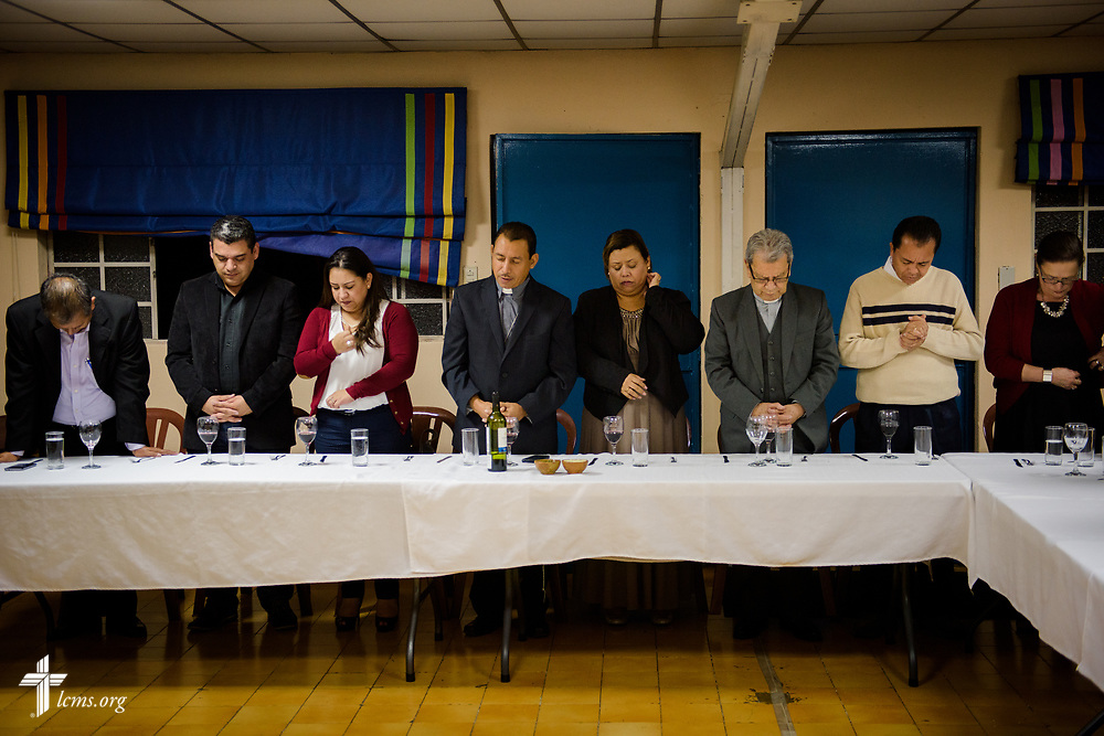 Guatemalan pastors and spouses pray at a fellowship event following evening service on Wednesday, Oct. 4, 2017, at Iglesia Luterana de Cristo Rey (Christ the King) in Guatemala City, Guatemala. LCMS Communications/Erik M. Lunsford