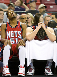 November 27, 2009; Sacramento, CA, USA;  New Jersey Nets forward Sean Williams (51) and center Josh Boone (2) react as their team falls to 0-16 at the end of the game against the Sacramento Kings at the ARCO Arena. Sacramento defeated New Jersey 109-96.