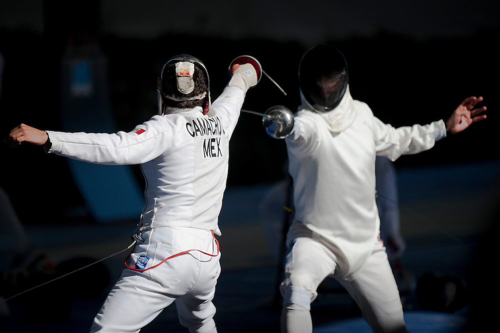 Oct. 16, 2011 - Guadalajara, Mexico – Abraham Camacho from Mexico and Abel Alvarez from Cuba fence during the Pentathlon, where athletes compete in fencing, swimming, equestrian, shooting, and running at the Hipcia Club on the second day of the Pan American Games..Benjamin Brian Morris ©2011