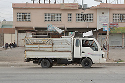 Licensed to London News Pictures. 10/11/2016. Mosul, Iraq. Residents of Mosul's Gogjali District fly a white flag from their truck to show they pose no threat to Iraqi Security Forces operating nearby.<br /> <br /> The battle to retake Mosul, which fell June 2014, started on the 16th of October 2016 with Iraqi Security Forces eventually reaching the city on the 1st of November. Since then elements of the Iraq Army and Police have succeeded in pushing into the city and retaking several neighbourhoods allowing civilians living there to be evacuated - though many more remain trapped within Mosul. Photo credit: Matt Cetti-Roberts/LNP
