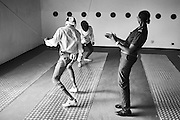 Prison guard Fatoumata Sy referees a fencing match between minors who are incarcerated at a nearby prison and participating in a fencing session at a studio in the city of Thiès, Senegal on April 14, 2015. Supported by OSIWA, organisation 'Pour un sourire d'enfant'  has implemented the sport of fencing as a form of restorative justice in a minor's prison for males and females in the city of Thiès, Senegal. This innovative judicial method works as a restorative rather than punitive approach to justice. Fencing is an effective method for helping incarcerated young people build self-confidence and respect (both for themselves and others), and engender discipline and determination.