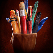 Hands painted to look like a pencil pot Ray Massey is an established, award winning, UK professional  photographer, shooting creative advertising and editorial images from his stunning studio in a converted church in Camden Town, London NW1. Ray Massey specialises in drinks and liquids, still life and hands, product, gymnastics, special effects (sfx) and location photography. He is particularly known for dynamic high speed action shots of pours, bubbles, splashes and explosions in beers, champagnes, sodas, cocktails and beverages of all descriptions, as well as perfumes, paint, ink, water – even ice! Ray Massey works throughout the world with advertising agencies, designers, design groups, PR companies and directly with clients. He regularly manages the entire creative process, including post-production composition, manipulation and retouching, working with his team of retouchers to produce final images ready for publication.