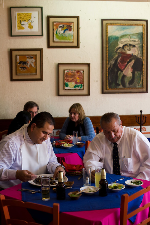 Men have lunch at El Bajio, a well known restaurant in Mexico City for traditional mexican cuisine.