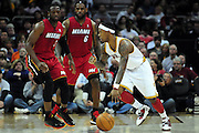March 29, 2010; Cleveland, OH, USA; Cleveland Cavaliers point guard Daniel Gibson (1) drives past Miami Heat shooting guard Dwyane Wade (3) and small forward LeBron James (6)  at Quicken Loans Arena. The Cavaliers beat the Heat 102-90. Mandatory Credit: Jason Miller-US PRESSWIRE