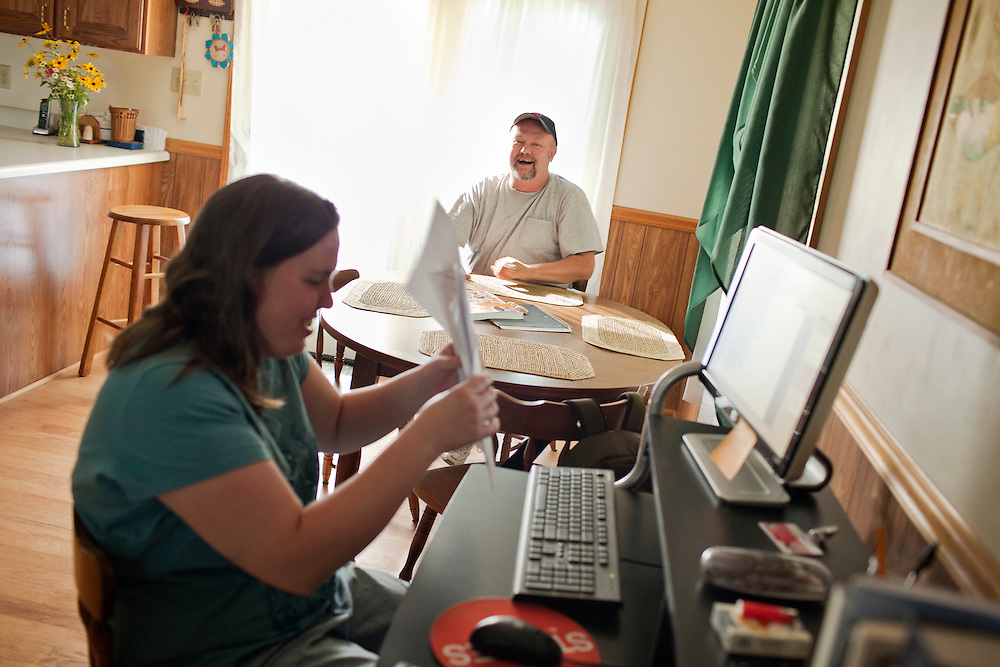 David Styles, 50, talks with his wife, Jennifer, as she helps out with his homework for a development psycology class inside their home near Marion, North Carolina, Sunday, June 20, 2010. Styles is enrolled in classes to become a certified nursing assistant after the textile mill he worked at for nearly 30 years closed down and left him struggling to pay the mortgage on his home. Thanks to the North Carolina Housing Finance Agency and its Home Protection Program, Styles now receives assistance to cover his mortgage and has up to 15 years to pay it back interest-free. ..State News NC: foreclosure.Wichita/Bellovin Bulletin.Model Released: Yes.