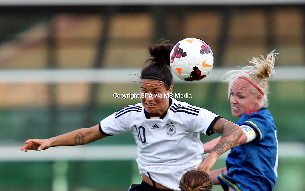 Fifa Womans World Cup Canada 2015 - Preview //<br /> Algarve Cup 2015 Tournament ( Vila Real San Antonio Sport Complex - Portugal ) - <br /> Germany vs Sweden 2-4   -  Caroline Seger of Sweden (R) , challenges with Dzsenifer Marozsan of Germany (L)