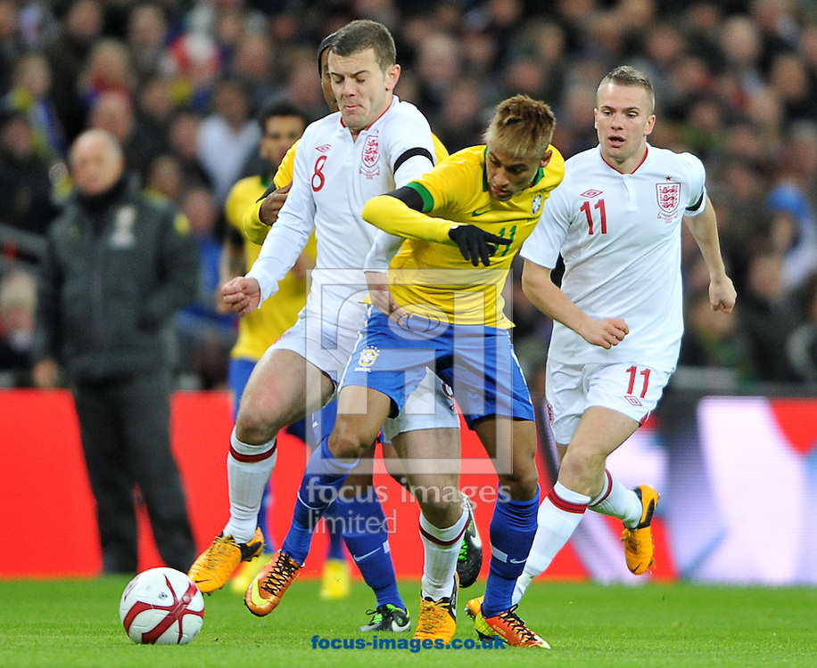 Picture by Daniel Hambury/Focus Images Ltd +44 7813 022858.06/02/2013.Jack Wilshere of England and Neymar of Brazil in action during the Friendly match at Wembley Stadium, London.