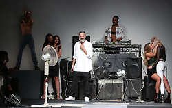 Fashion designer Ashish Gupta acknowledges the audience following his show at London Fashion Week September 2018 show at BFC Space in London