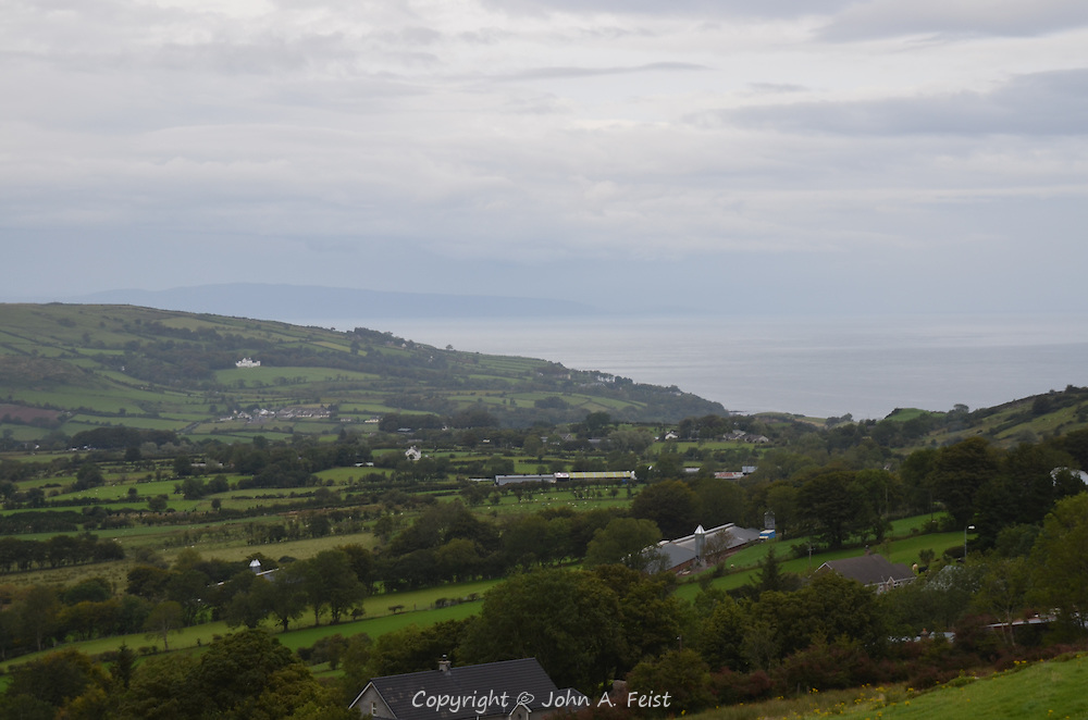 The peaceful farmland of Cushendall, County Antrim, Northern Ireland sloping down to the sea.