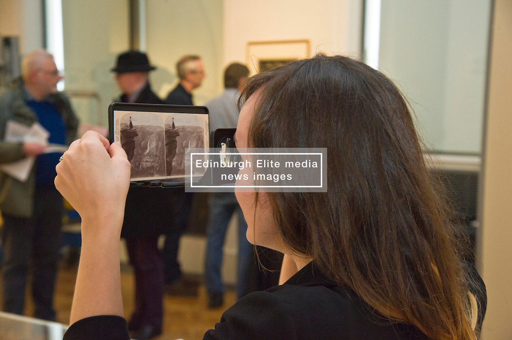 Jill Brown tries out the steroscopic viewer to get that 3d look.<br /> <br /> The View from Here exhibition at the Scottish National Portrait Gallery in Edinburgh brings together 70 key works charting the history of landscape and photography over 175 years. <br /> <br /> (c) Ger Harley | Edinburgh Elite media