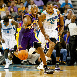 Dec 5, 2012; New Orleans, LA, USA; Los Angeles Lakers shooting guard Kobe Bryant (24) drives down court as New Orleans Hornets small forward Lance Thomas (42) pursues the play during the first half of a game at the New Orleans Arena.  Mandatory Credit: Derick E. Hingle-USA TODAY Sports