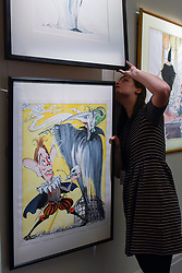 "© Licensed to London News Pictures. 31/03/2017. London, UK. A staff member inspects ""Tony Blair and the Ghost of Conservatisim"" by Gerald Scarfe, (Est. GBP 5-7k), depicting Tony Blair and Margaret Thatcher.  Press preview of ""Made in Britain"" at Sotheby's in New Bond Street.  The auction on 5 April celebrates innovative British art in the twentieth century as well as artwork by political cartoonist Gerald Scarfe. Photo credit : Stephen Chung/LNP"