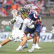 JoJo Marasco #1 of the New York Lizards runs with the ball past Brendan Porter #3 of the Boston Cannons during the game at Harvard Stadium on July 19, 2014 in Boston, Massachusetts. (Photo by Elan Kawesch)