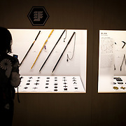 "TOKYO, JAPAN - JULY 2 : A woman look at ninja's weapon on display during a ninja exhibition that kicks off Saturday at Miraikan in Tokyo, Japan on July 2, 2016. A special exhibition entitled ""The Ninja- who were they?"" will be open from July 2 (Saturday), 2016 to October 10 (Monday) 2016 at the Miraikan (National Museum of Emerging Science and Innovation). Photo: Richard Atrero de Guzman"