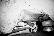 A newborn baby sleeps in the Technical College used as temporary shelter for flood-affected families. <br />