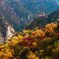 Medieval fortress in a mountain hill at autumn time