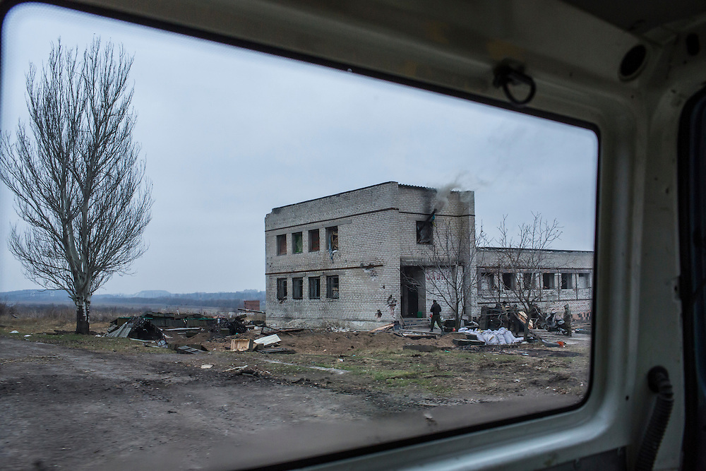 PISKY, UKRAINE - NOVEMBER 17, 2014: An abandoned building which is being used by pro-Ukraine militia members as a base from which to fight against pro-Russia rebels for control of the Donetsk airport, in Pisky, Ukraine. CREDIT: Brendan Hoffman for The New York Times