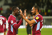 Aston Villa midfielder Ahmed Elmohamady (27) and Aston Villa midfielder Albert Adomah (37) celebrate after the final whistle during the EFL Sky Bet Championship match between Derby County and Aston Villa at the Pride Park, Derby, England on 10 November 2018.