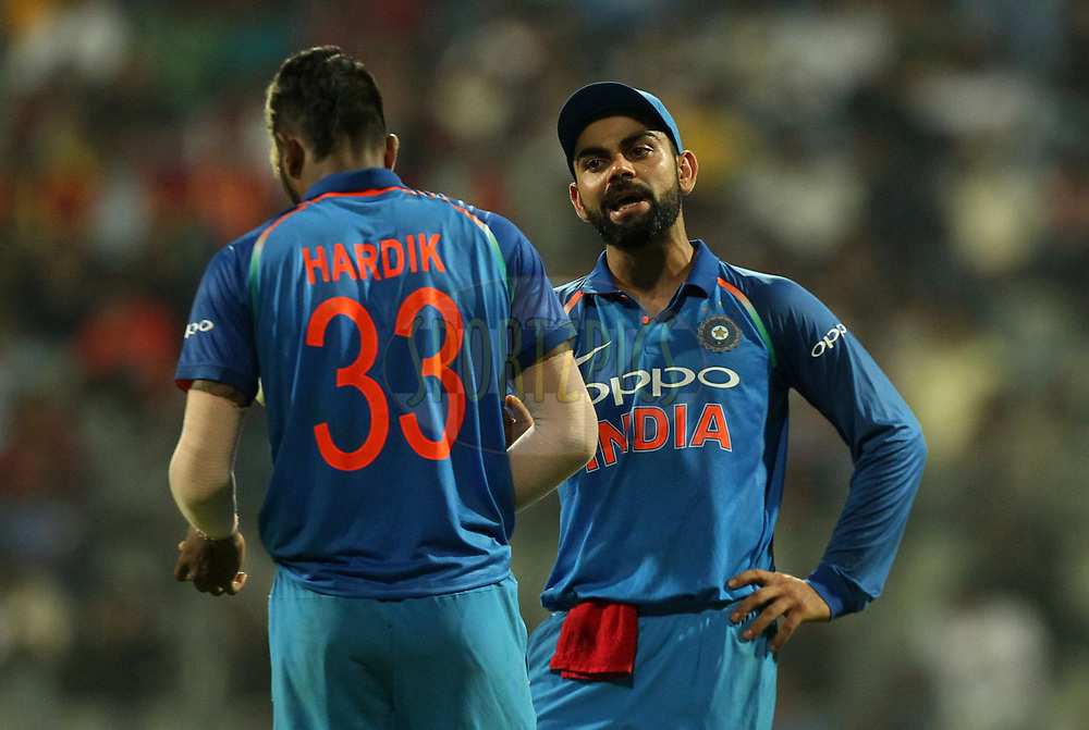 Virat Kohli captain chats with Hardik Pandya of India during the 1st One Day International match between India and New Zealand held at the Wankhede Stadium in Mumbai on the 22nd October 2017Photo by Prashant Bhoot / BCCI / SPORTZPICS