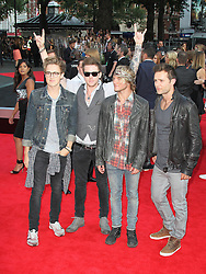 © Licensed to London News Pictures. 20/08/2013, UK. Tom Fletcher; Danny Jones; Dougie Poynter; Harry Judd; McFly,   One Direction: This Is Us - World film premiere, Leicester Square, London UK, 20 August 2013<br />  Photo credit : Richard Goldschmidt/Piqtured/LNP