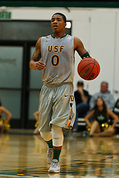 Dec 10, 2011; San Francisco CA, USA;  San Francisco Dons guard Dominique O'Connor (0) dribbles the ball against the Pacific Tigers during the first half at War Memorial Gym.  San Francisco defeated Pacific 79-69. Mandatory Credit: Jason O. Watson-US PRESSWIRE