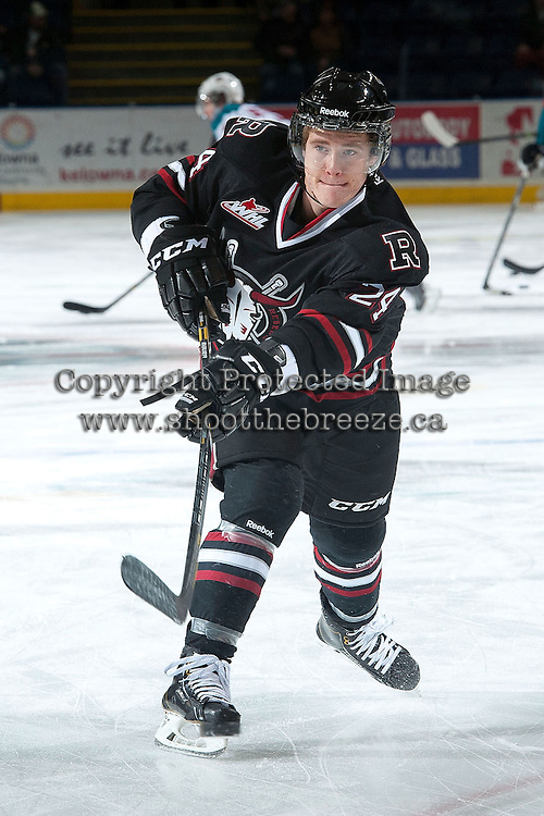 KELOWNA, CANADA -FEBRUARY 5: Aspen Sterzer C #24 of the Red Deer Rebels takes a shot during warm up against the Kelowna Rockets on February 5, 2014 at Prospera Place in Kelowna, British Columbia, Canada.   (Photo by Marissa Baecker/Getty Images)  *** Local Caption *** Aspen Sterzer;