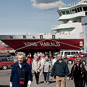 Three weeks aboard the Kong Harald. Hurtigruten, the Coastal Express. People going down of ship in Sandnessjoen.